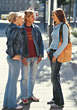 Stock Photo : Meeting Stock Image: Teenagers Talking Standing on Sidewalk