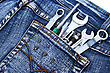 Tools In Blue Jeans Pocket On White Background. stock image