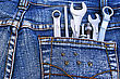 Tools Set In Blue Jeans Pocket. - stock photography