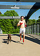 Athletic Training Before The Fight. Boxer And Dog Running Outdoors. stock photography