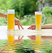 Two Human Hands, Man And Woman With Beer In Glass.