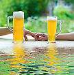 Two Human Hands, Man And Woman With Beer In Glass