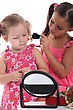 Two Little Girls Playing With Make-up stock photography