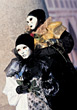 Two Performers Wearing Theater Masks