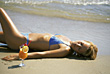 Stock Photo : Beach Stock Photo: Woman Laying on Beach