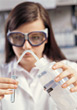 Woman Wearing Safety Glass Conducting Experiment