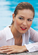 Poses Woman with Wet Blouse at Swimming Pool - stock image