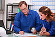 Stock Photo : Serious Stock Photography: Worker And Intern Checking Stock Levels