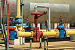 Industry Yellow Gas Pipe And Valve Red, Blue Dotted Gate stock image