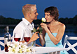 Young Couple at Romantic Dinner By The Water