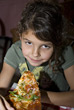 Stock Photo : People Eating  Stock Image: Young Girl Eating Pizza