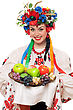 Young Woman In The Ukrainian National Clothes With Fruit. stock photography