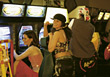 Young Women At Videogame Arcade