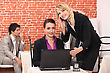 Stock Photo : Conference Table Pictures: Young Women Using A Laptop In A Restaurant